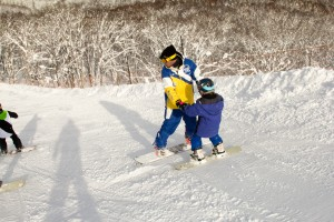 Snowboard pro Maxime offering help to one of his students